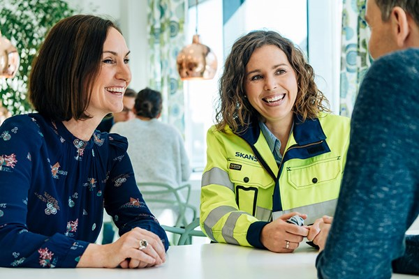 Two women and a man planning Skanska Safety Week activities.